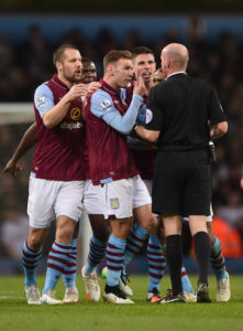 Aston Villa players surround referee Lee Mason (Source: Michael Regan/Getty Images Europe)